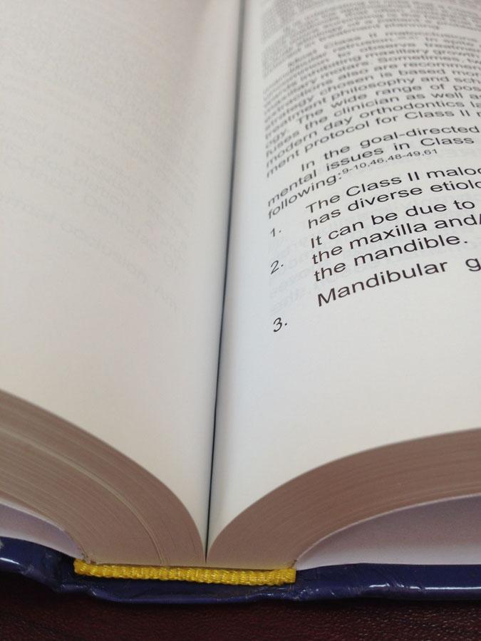 Твердый переплет изготовление книг и дипломов в твердом переплете  Ручная прошивка проклеенного книжного блока
